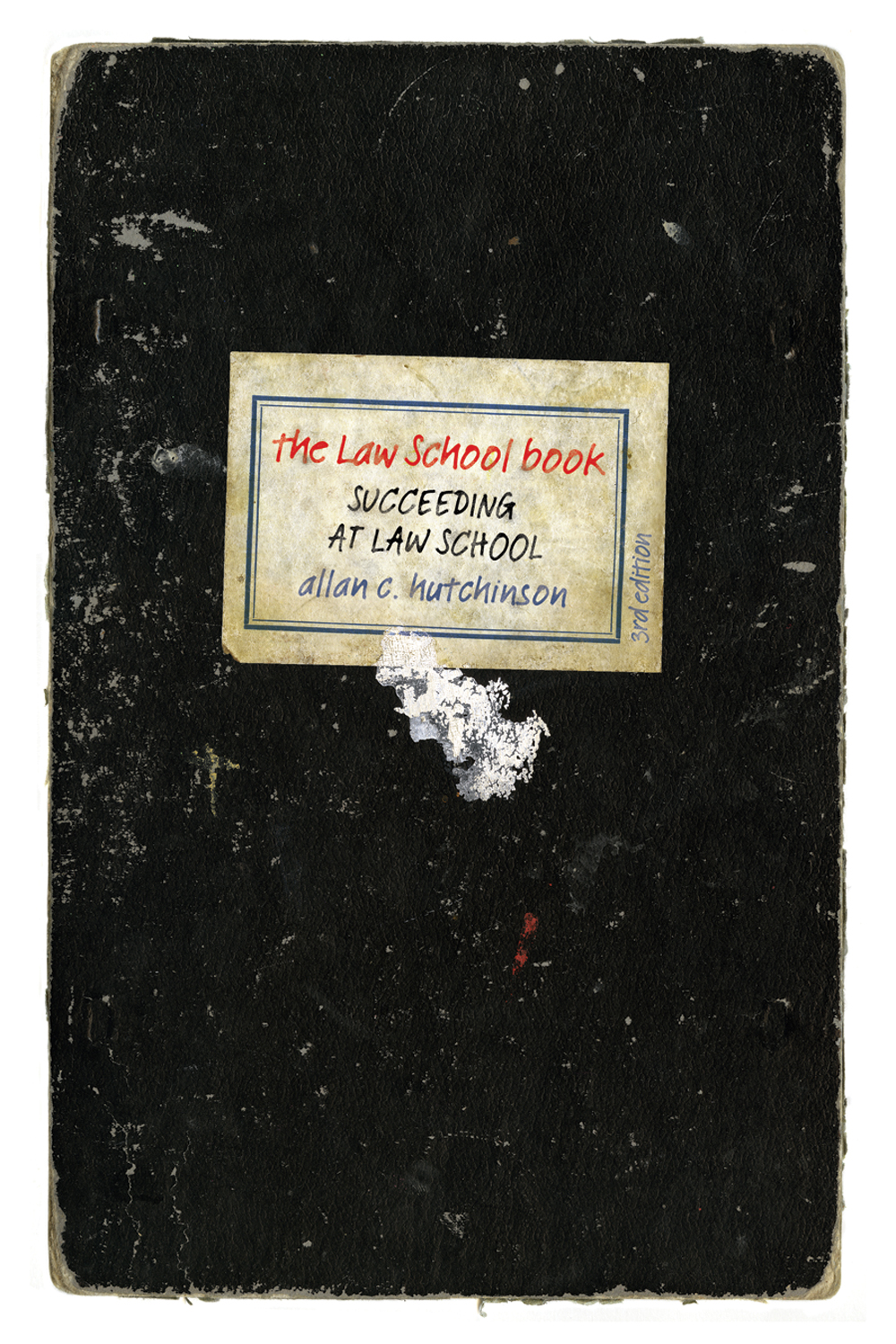 Book cover for Law School Book by Allan Hutchinson, showing a worn notebook with a label with modern font that looks like handwriting.