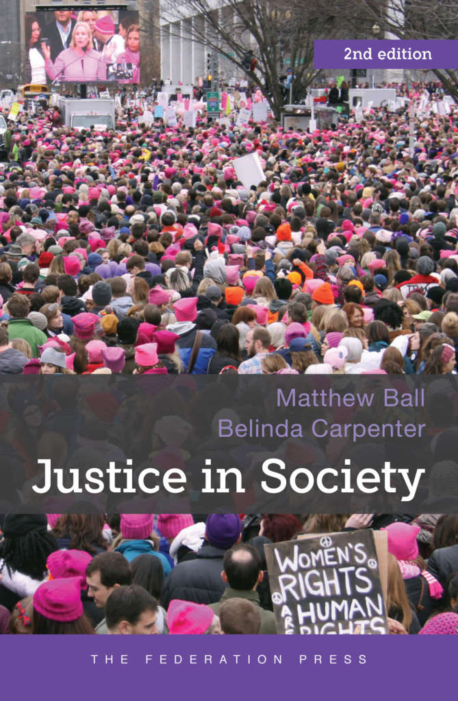 "Book cover for Justice in Society by Matthew Ball and Belinda Carpenter. It shows a crowd of people at a demonstration. Many are wearing pink ""pussyhats"". One person is holding a sign saying ""Women's rights are human rights."""